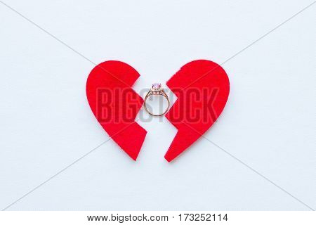Broken Heart And Wedding Ring Close-up On A White Background