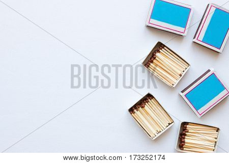 Matchboxes On White Background With Space For Text