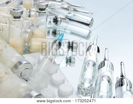 Glass vials of vaccine. Medications for injection on transparent glass
