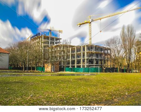 Construction of new apartments and crane on the long exposure