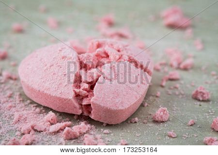 Broken Candy Heart with Crushed Candy Bits Strewn Around