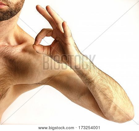 Man's hand shows ok on a white background