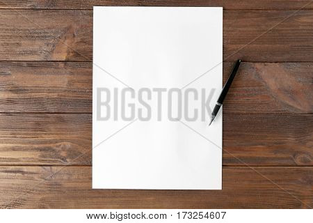 Paper and pen on wooden table