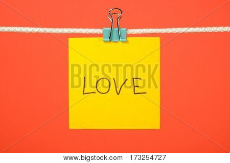 Yellow Paper Note On Clothesline With Text Love