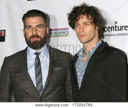 LOS ANGELES - FEB 23:  Zachary Quinto, Miles McMillan at the 12th Annual Oscar Wilde Awards at Bad Robot Studios on February 23, 2017 in Santa Monica, CA