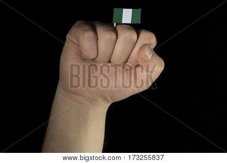 Man Hand Fist With Nigerian Flag Isolated On Black Background