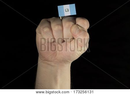 Man Hand Fist With Guatemalan Flag Isolated On Black Background