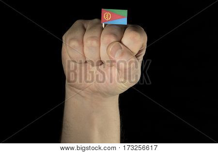 Man hand fist with Eritrean flag isolated on black background poster