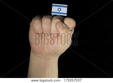 Man Hand Fist With Israeli Flag Isolated On Black Background