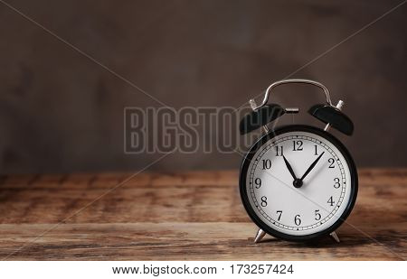 Alarm clock on wooden table