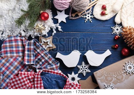 Gifts and Christmas decorations on wooden background
