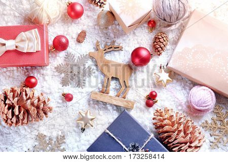 Gift boxes and Christmas decorations on wooden background