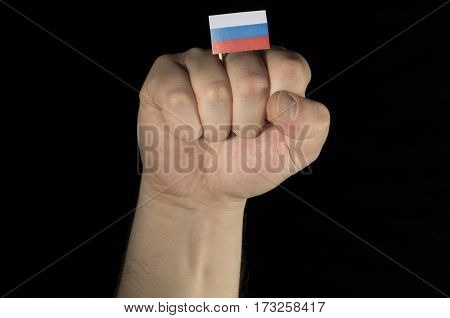 Man Hand Fist With Russian Flag Isolated On Black Background
