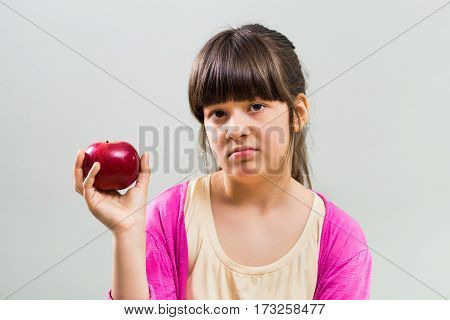 Little girl doesn't want to eat fruit .