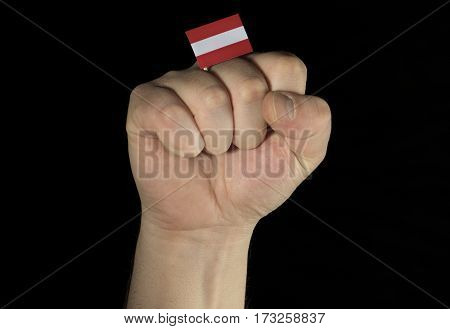 Man Hand Fist With Austrian Flag Isolated On Black Background