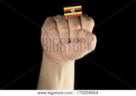 Man Hand Fist With Ugandan Flag Isolated On Black Background