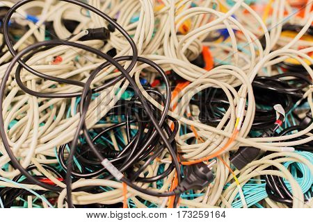 Old network cables and power cables in a pile for disposal