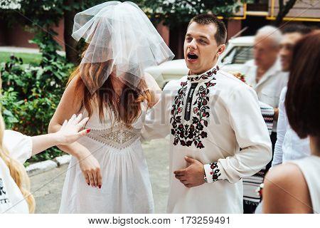 Stylish Groom Having Fun With Fake Bride, Wedding Ceremony