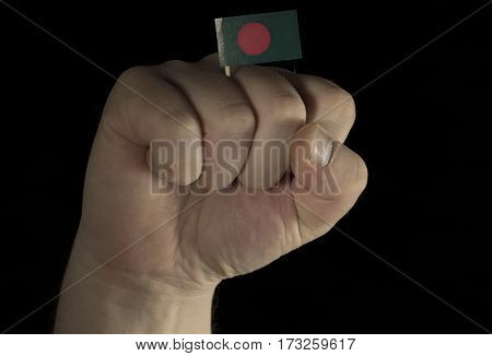 Man Hand Fist With Bangladeshi Flag Isolated On Black Background