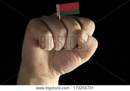 Man Hand Fist With Belarusian Flag Isolated On Black Background