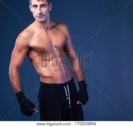 portrait of hand wrapping half nude boxer