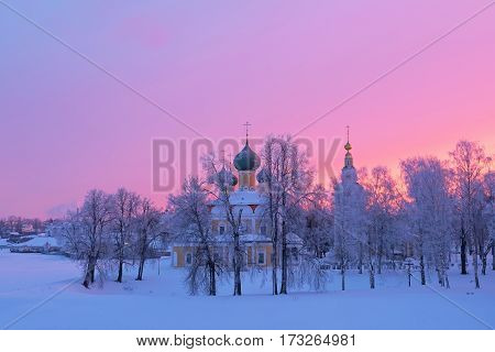 Transfiguration Cathedral of the Uglich Kremlin in the background of a winter sunrise, Russia