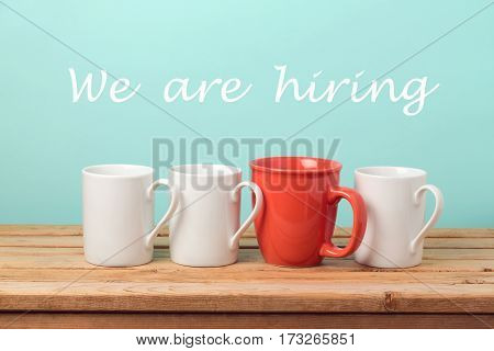 Job recruit concept with coffee cups and text