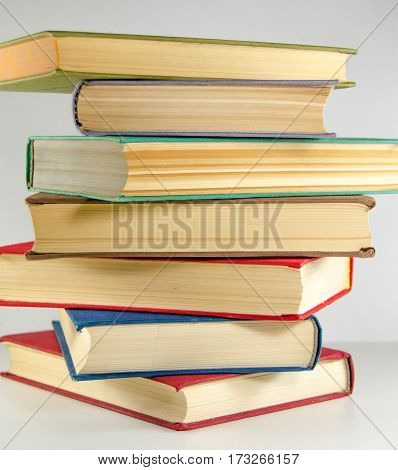 books stack of seven pieces on a white background
