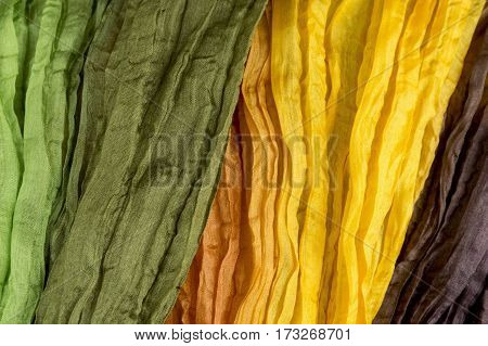 green and orange shirred fabric silk texture multi-colored