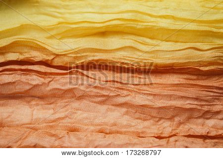 yellow and orange  shirred fabric silk texture