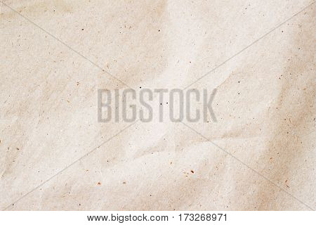 Rumpled Environmental or Kraft paper texture background close-up. Grunge old paper surface texture.