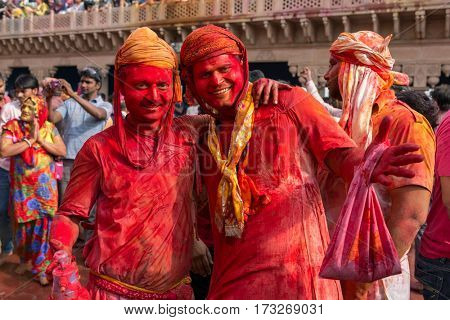 Nandgaon, India - March 18, 2016: Two unidentified men with face smeared with colors during Holi celebration in Nandgaon, Uttar Pradesh, India.
