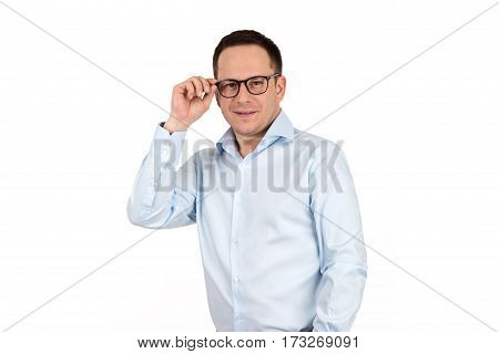 Young handsome man in white shirt wearing fashion eyeglasses against white background with lots of copy space