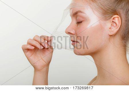 Woman Removing Facial Peel Off Mask.