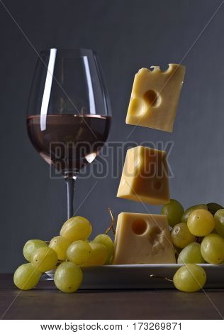 Magic Cheese With Grape And Glass Of Wine