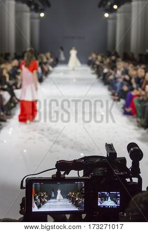 KYIV, UKRAINE - OCTOBER 13, 2016: Televison camera broadcasting a show during the 39th Ukrainian Fashion Week at Mystetsky Arsenal in Kyiv