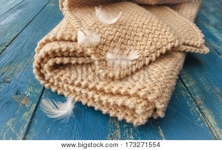 Soft warm blanket on a wooden surface