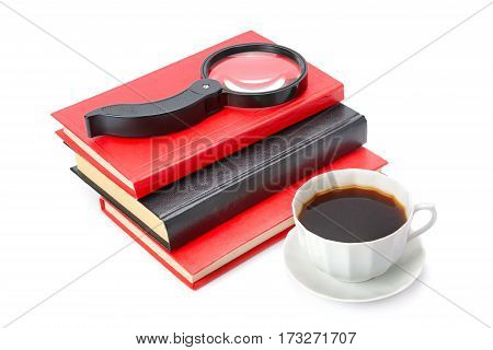 Books a cup of coffee and magnifier isolated on white background