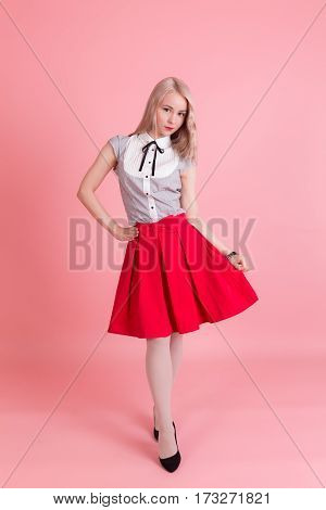 Portrait of slim girl in a red skirt