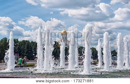 Summer day at Poklonnaya hill in Moscow fountains with vertical jets of water