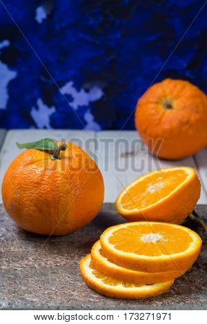 Giant ripe organic oranges from farm in Spain with leaves on the market