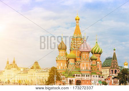 Saint Basil's Cathedral in Moscow with main department store (GUM) on the background