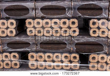 Briquettes of coal, economical heating, background, objects