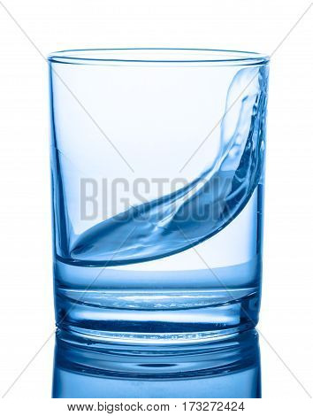 Blue Water In Transparent Glass With Splash Isolated Over White, Background, Close Up