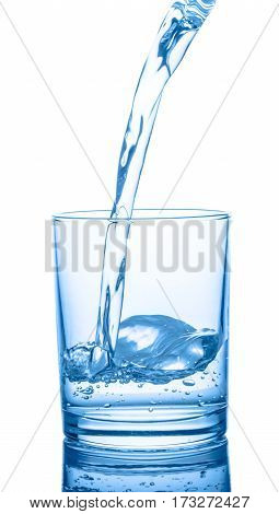 Pouring Blue Water In Transparent Glass Isolated On White Background, Close Up