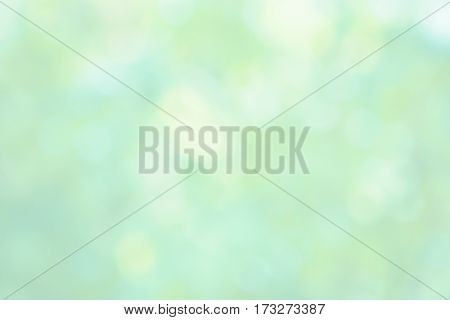 Spring Background. Delicate Beautiful Abstract Green yellow White backdrop. Soft Texture with Light spots. Pastel Wallpaper With Copy Space defocused