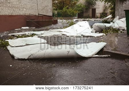 Ruins of wall isolating cover after heavy rain and wind