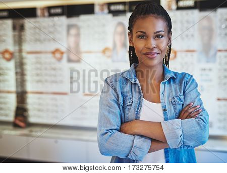 Confident Woman With Folded Arms At Store