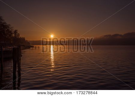 A calm sunset on the shore of a lake in germany