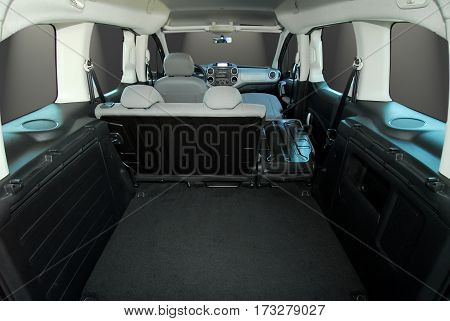 Empty trunk with folded seats of the large passenger car